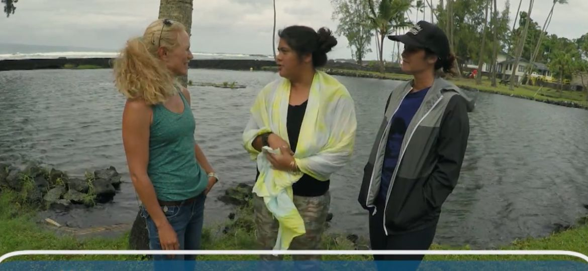 UH Sea Grant Kanesa Duncan Seraphin talking with Kamala Anthony and Cherie Kauahi in front of Waiuli fishpond.