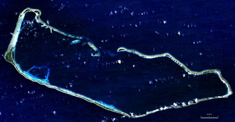 A satellite image of the rectangular ring of Majuro Atoll in the midst of a blue sea.