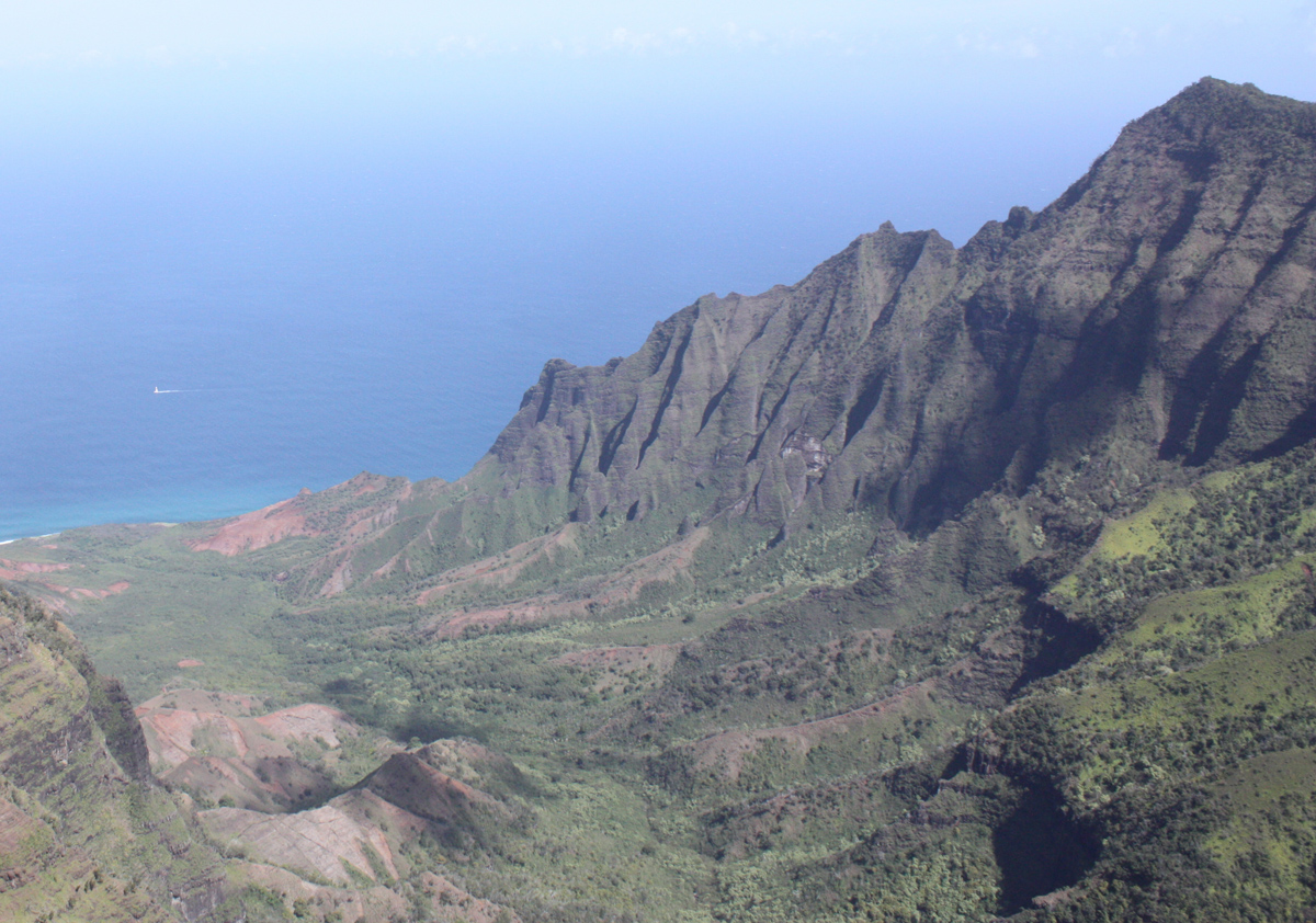 Overview of a large Hawaiian valley, looking out to the sea beyond
