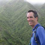Portrait of Jeff Burgett in front of mountainside.